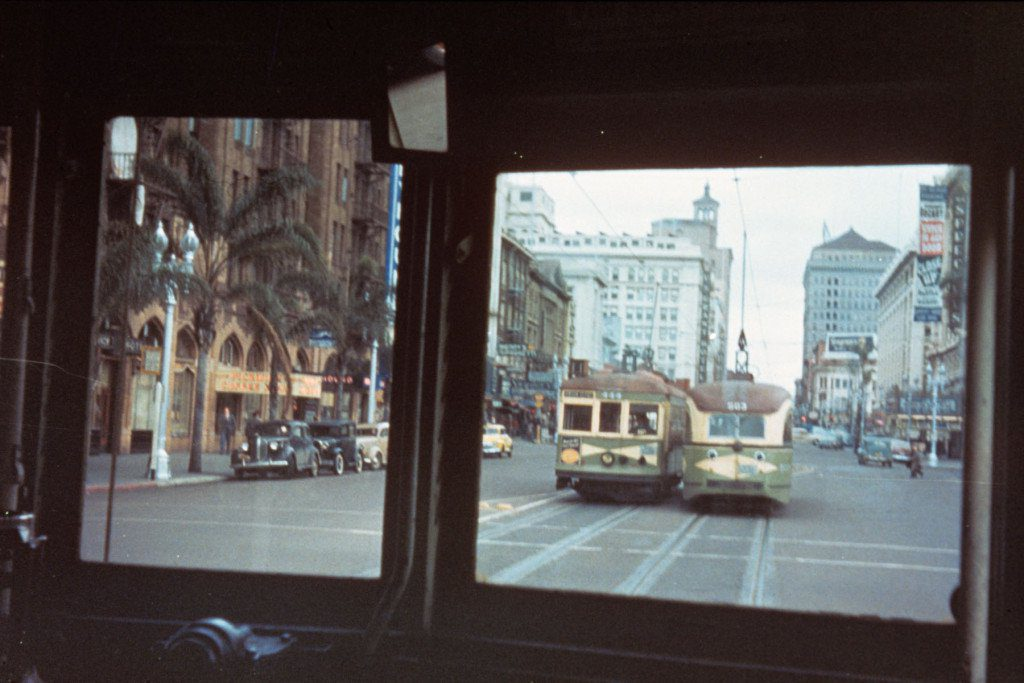 San Diego Electric Railway streetcars on Broadway in downtown San Diego, viewed through the windshield of another car. Looking east on Broadway from Front St. in the late 1940s.