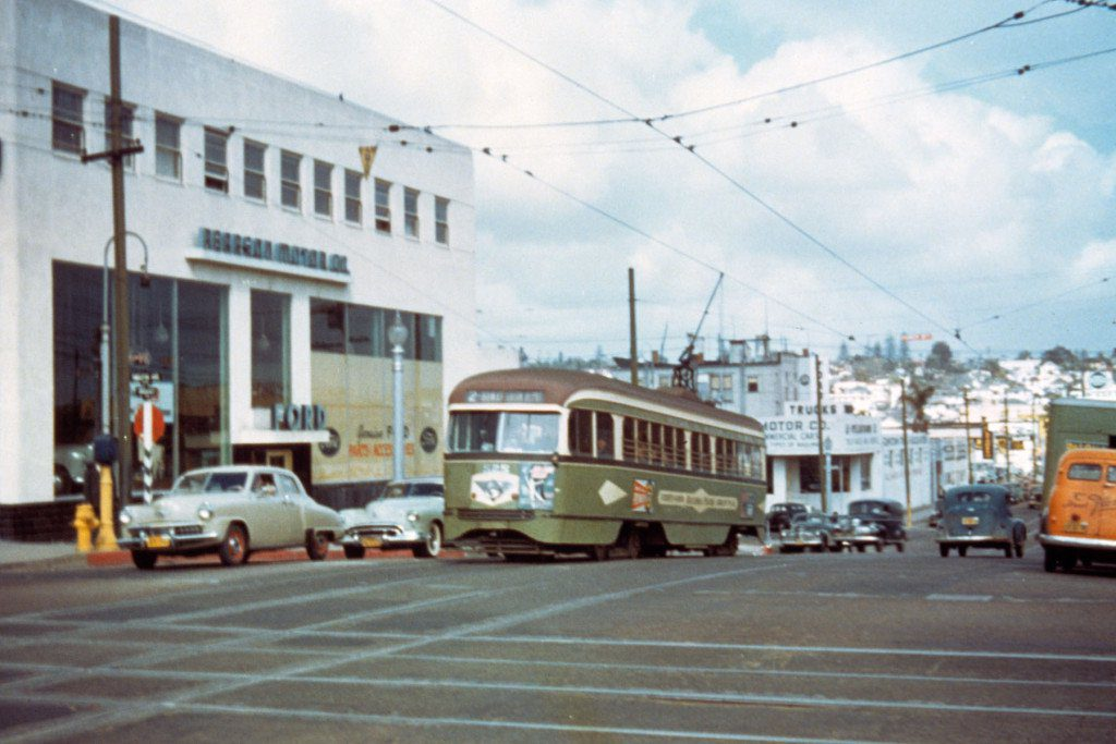 San Diego Electric Railway PCC streetcar travels westbound on Broadway between 12th Ave. and 13th St. in the late 1940s. The auto dealership on the left is the Pearson Motor Company, later located on El Cajon Blvd.