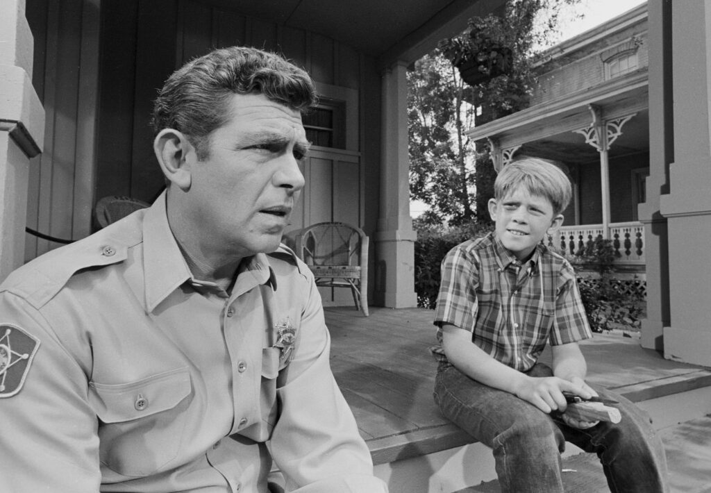 "LOS ANGELES - JUNE 20: THE ANDY GRIFFITH SHOW ep: ""Opie's Girlfriend"". Andy Griffith and Opie (Ron Howard). (Photo by CBS via Getty Images) *** local caption *** Ron Howard;Andy Griffith"