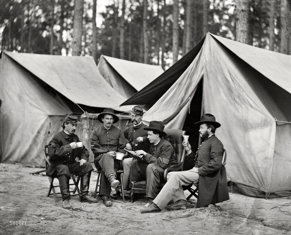 "October 1864. ""Petersburg, Virginia. Hospital stewards of 2d Division, 9th Corps, in front of tents."""