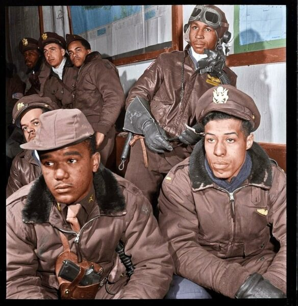 """332nd Fighter Group airmen at a briefing in Ramitelli, Italy. March 1945. Foreground: Emile G. Clifton of San Francisco and Richard S. """"Rip"""" Harder of Brooklyn."""
