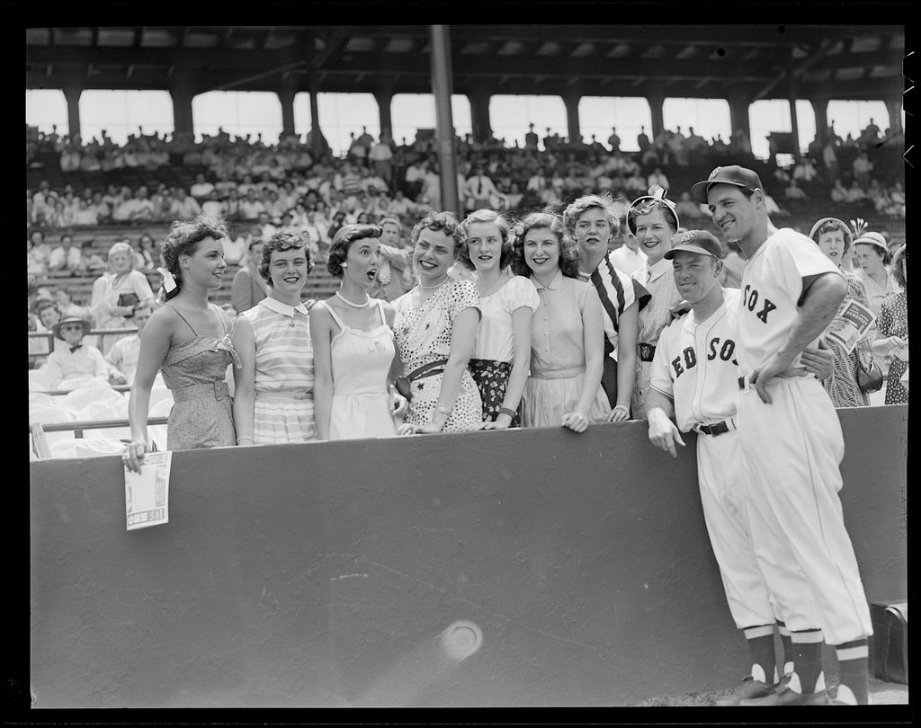 Vern Stephens and Walt Dropo are visited by a group of lovely ladies at Fenway
